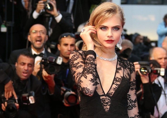 Model Cara Delevingne poses on the red carpet as she arrives for the screening of the film 'The Great Gatsby' and for the opening ceremony of the 66th Cannes Film Festival in Cannes