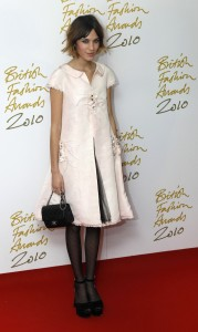 Model Alexa Chung poses for photographers as she arrives for the British Fashion Awards at the Savoy Theatre, in central London