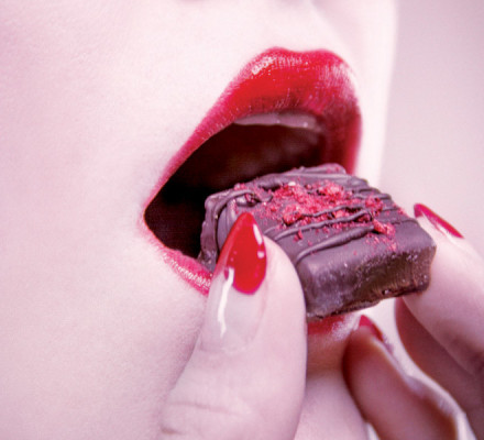 Close up of woman eating chocolate