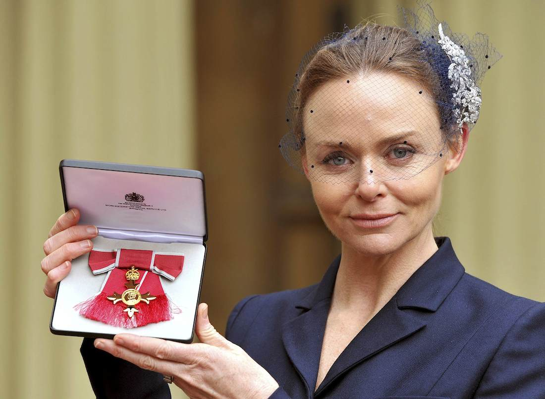 Fashion designer Stella McCartney holds her Officer of the British Empire (OBE) award at Buckingham Palace after the Investiture Ceremony in central London