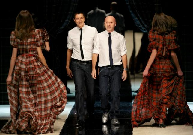 Italian designers Dolce and Gabbana acknowledge applause on the catwalk at the end o of  D&G Fall/Winter 2008/09 women's collection during Milan Fashion Week.