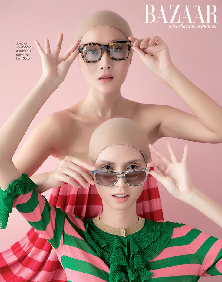 Áo hở vai sọc đỏ hồng, đầm xanh kẻ sọc và mắt kính Gucci