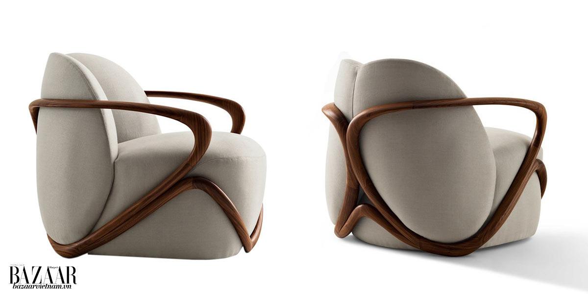 Mẫu ghế HUG được làm từ 20 khúc gỗ walnut tự nhiên, tạo nên khung mượt mà.