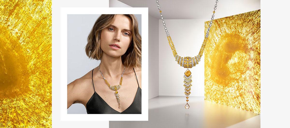 Thiết kế trang sức Cartier Yuma: Lấy cảm hứng từ mặt trời. Các sắc kim cương vàng và trắng tượng trưng cho sự lấp lánh của ánh dương.