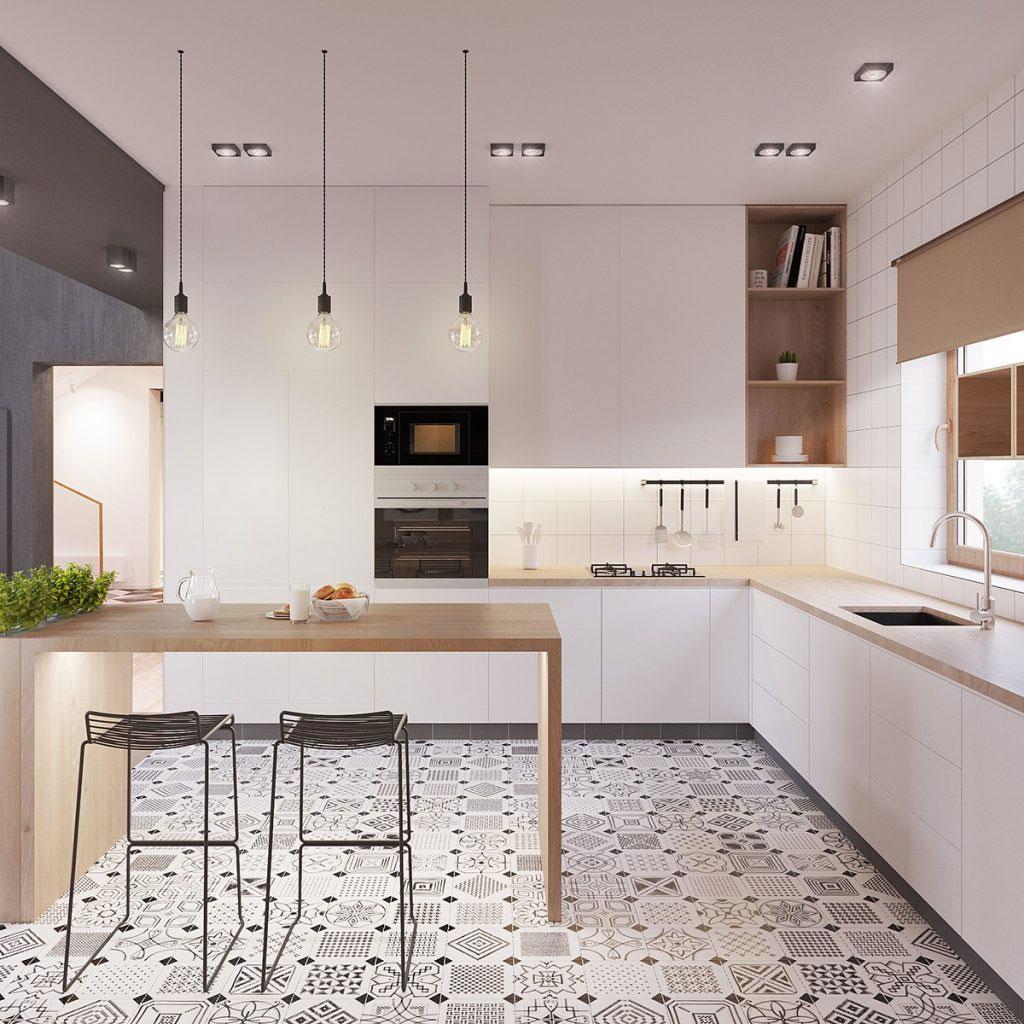 Phòng bếp này có rất nhiều nguồn sáng khác nhau: cửa sổ, đèn trần, đèn treo thả, đèn hộc tường trên kệ bếp, và đèn ở dưới chân bàn ăn. Ảnh: CE