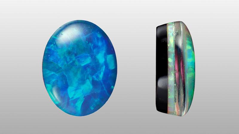 Một viên đá opal triplet. Nền đen là đá chalcedony, mặt trên gắn quartz bảo vệ lớp opal mỏng manh. Ảnh: GIA.edu