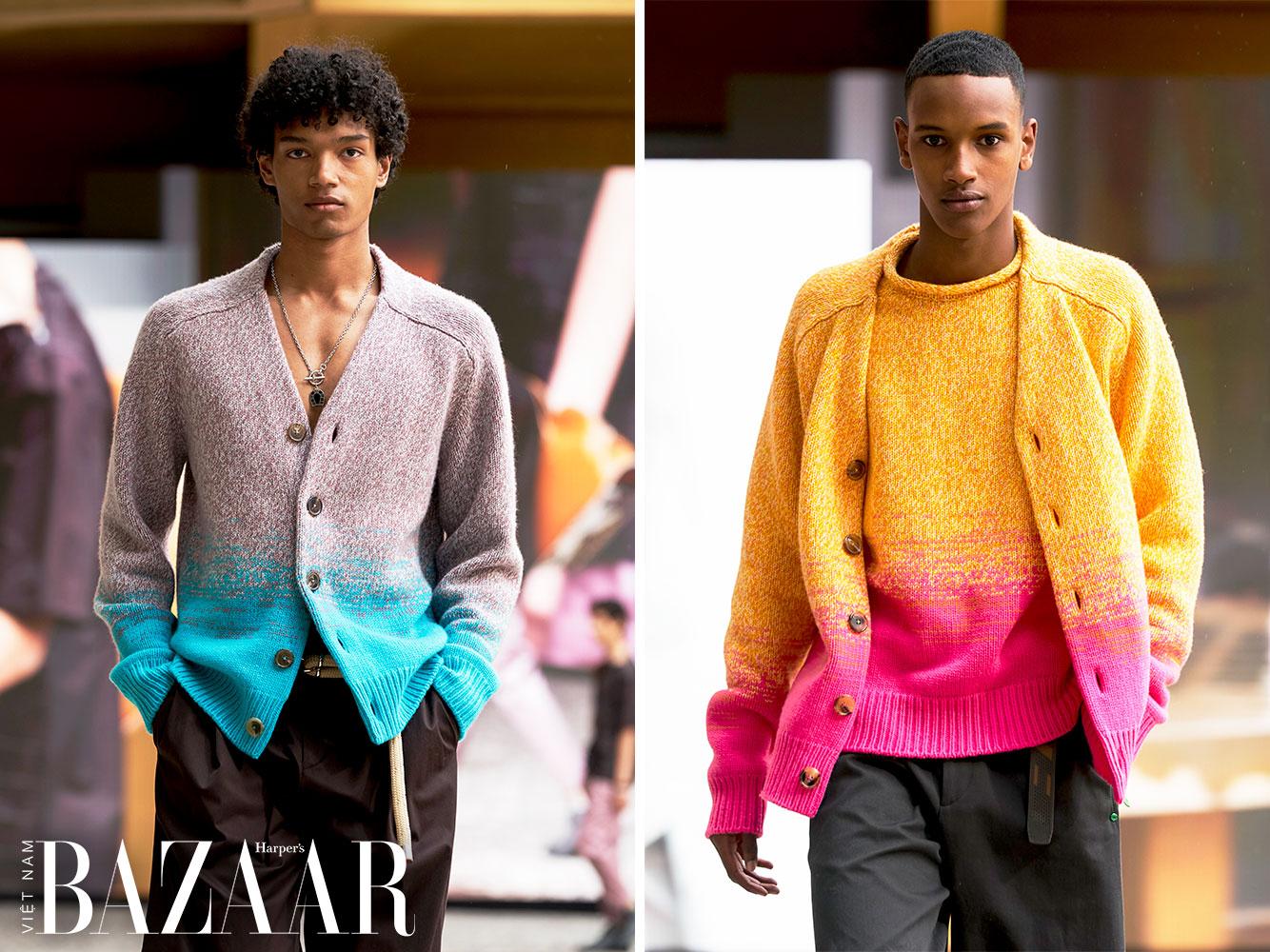 Tinh thần lạc quan bùng nổ trong BST Hermès Men Xuân Hè 2022, thể hiện qua những mẫu áo len cardigan gài cúc dệt ombré – chuyển màu từ cam sang hồng rực rỡ hay từ xám sang xanh ngọc sáng chói.